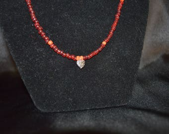 Red beaded necklace with heart pendant