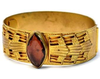 Vintage Victorian Revival amethyst glass wide brass hinged bangle bracelet