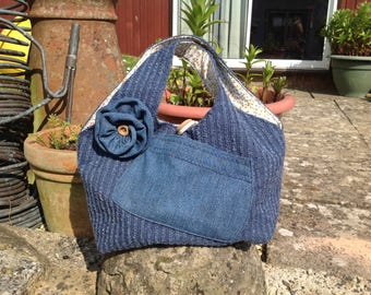 Chenille and Denim bag with flower. Wooden button closure
