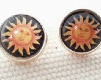 Sun Stud Earrings. Hand made in Brooklyn. Image of a happy Sun under a Crystal clear Glass dome.
