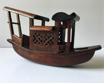 A pretty little Rosewood carving of a Chinese Junk
