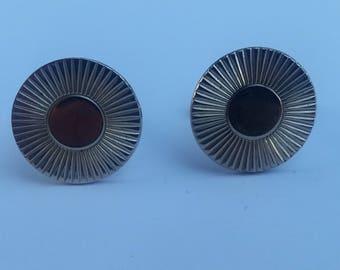 Gold tone round cuff links