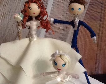 Bride and groom and flower girl customised cake topper