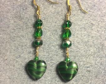 Opaque emerald green Czech glass heart bead dangle earrings adorned with emerald green Czech glass beads.