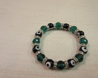 Black and emerald green evil eye beaded bracelet