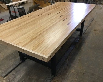 Dining table from reclaimed bowling lane