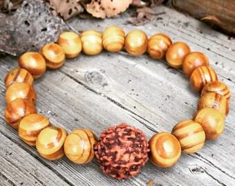 Natural grainy wood bead mala meditation yoga bracelet with large traditional Hindu Rudraksha seed bead unisex for men or women