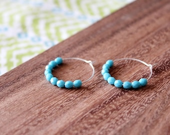 sterling silver bright blue czech glass hoop earrings