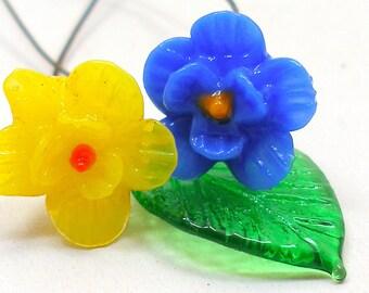 Tiny art glass flowers, 1930s Czech yellow & blue with leaf on wire stems.