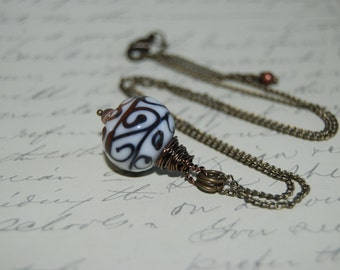 Wire Wrap Style White Ceramic with Brown Accent Necklace.