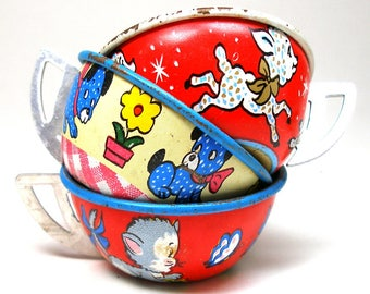 50s Tin Toy Tea Cups & Saucers, Set of 6 with kitty, puppy and lamb. By Ohio Art Co.