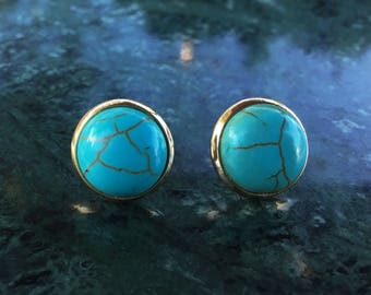 Faux blue turquoise round stud earrings In a gold frame