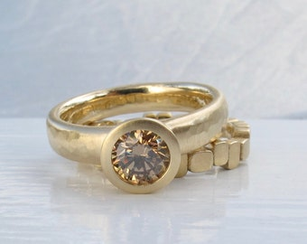 Recycled yellow gold and deep Champagne diamond bezel engagement ring low profile diamond solitaire ring with wide hammered band