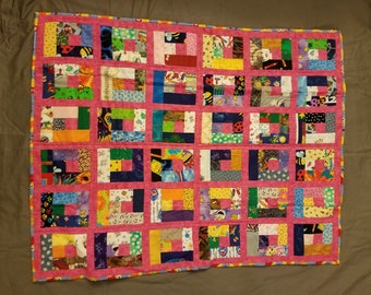 """Baby Quilt (33"""" x 41""""); Scrappy quilt with pink sashings and owl fabric on the back"""