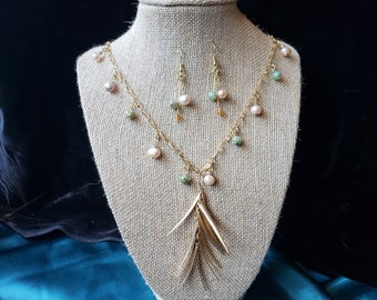 30 inch statement necklace with matching earrings made with fresh water pearls and rivershell