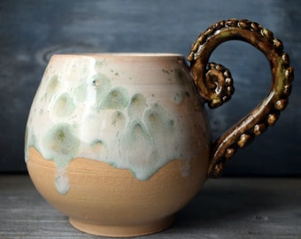 Large mug with a tentacle handle