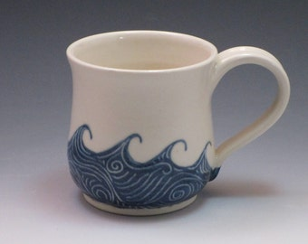Pottery mug / Porcelain coffee cup, hand thrown and hand painted in wave pattern