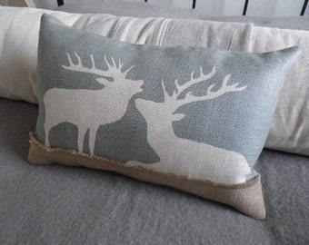 hand printed eau de nil stag pair cushion cover