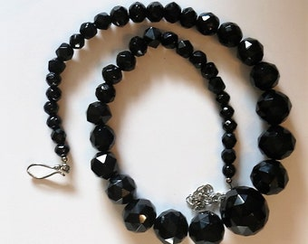 A Bold Black Multi Faceted Graduated Bead Necklace