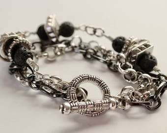 Silver and gunmetal chain bracelet with lava beads and toggle clasp