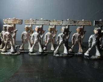 Vintage metal/ lead sailor by sign toy