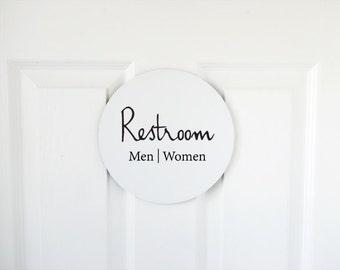 Clean modern restroom sign