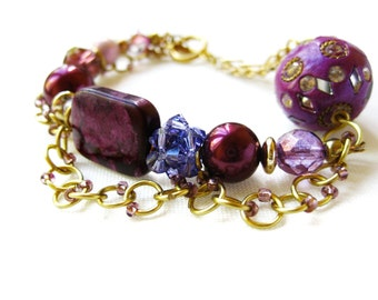 Purple and Gold Statement Bracelet with Chain Draping Gemstones Crystals and Pearls Chunky Carnival Asymmetrical Design Arm Party