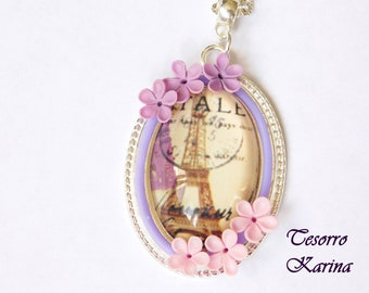 pendant on a chain with a glass cabochon and flowers from polymer clay, a floral pendant of a handmade