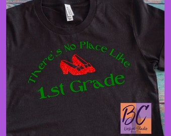 There's No Place Like 1st Grade Wizard of Oz Ruby Red Glitter Shoes Women's Black Bella Canvas T-Shirt S M L XL 2XL