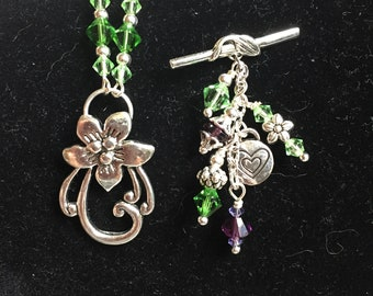 Necklace with hanging green and purple swavorski crystals