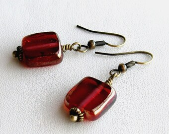 Antique brass and raspberry glass earrings