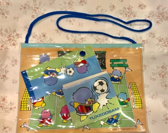 Vintage Tuxedosam bag with sketch pad,coloring stickers and color pencils .Made in Japan 1984