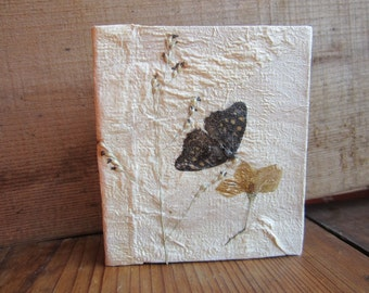 """Small notebook with unspun silk fibers and decorated with natural materials. Size: about 3.9"""" x 3.31"""" or 10cm x 8,5 cm. no.08"""