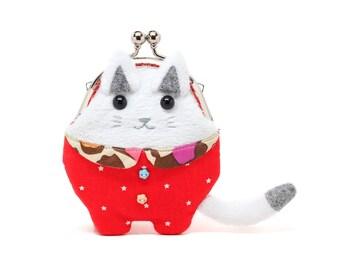 Zeno, the philosopher cat dressed in red