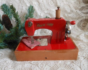 Red Toy Sewing Machine Kayanee Sew Master Germany Wooden Spool Vintage at Quilted Nest