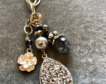 Sparkling silver druzy pendant on gold chain with sterling silver bali flower charm and gray crystal necklace on gold chain