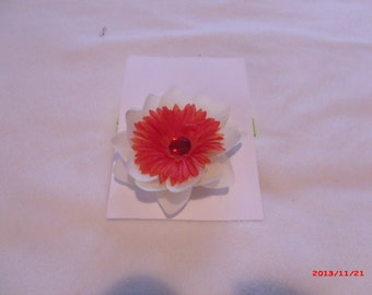 Off White Flower with Orange Flowers with a Jewel Center Pin
