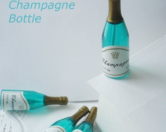 "CHAMPAGNE BOTTLE Cupcake NOVELTIES -  Perfect on cupcakes or cake. Champagne bottles measure approx. 3"" tall. Set of 12."