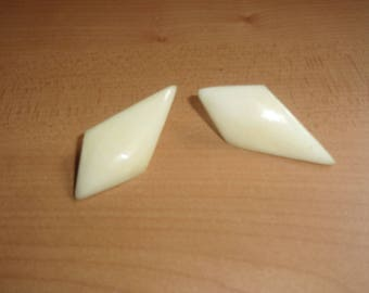vintage clip on earrings ivory colored lucite