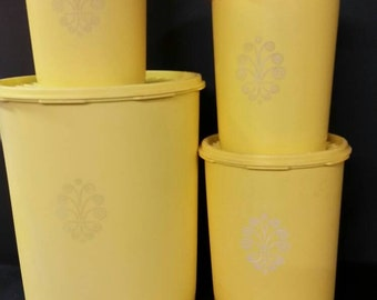 Vintage tupperware yellow canisters with lids. Set of 4