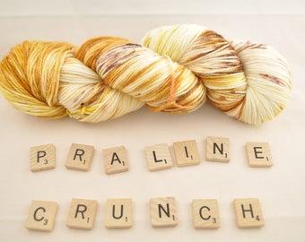 "Hand-dyed yarn, ""Praline Crunch"" variegated, lightly speckled, soft and squishy yarn. Great for socks or shawls. 80/20/ Superwash wool/Nylon"