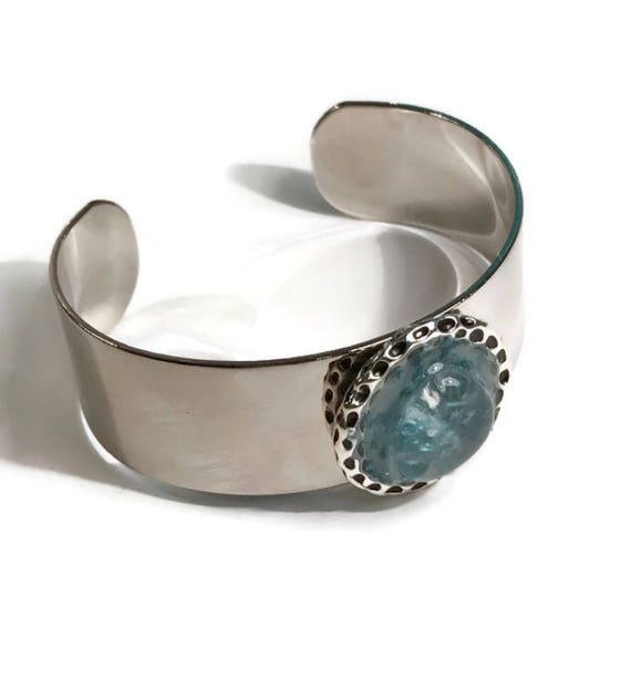 Shiny metal cuff bracelet with sea glass embedded in resin