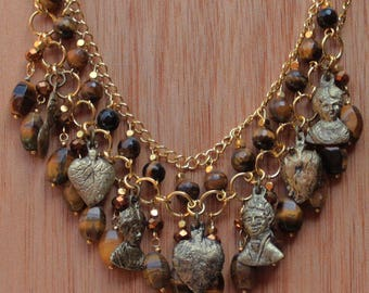 Mexican Milagro necklace with gold colored Milagros with tigers eye beads