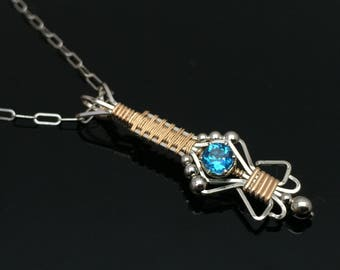 London Blue Topaz Charm Pendant Mixed 14 karat gold with Argentium Silver accents wire wrap designs by Ryan Eure