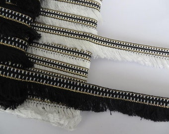 1m of pretty 3cm edge fringe trimming, black or white with gold