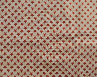 Fabric patch Kaufman cotton beige background with red and gold stars