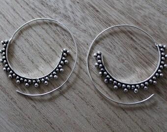 Large spiral hoop earrings