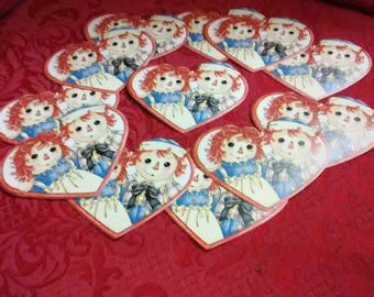 Vintage Raggedy Ann and Andy heart shaped wall paper trimmed in red. One dozen count.