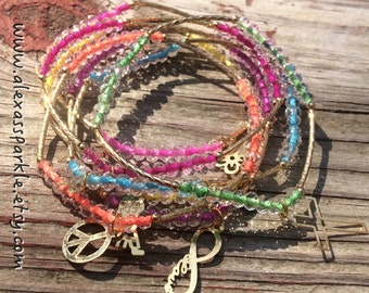 SALE: Clear Multicolor Bracelet Set with gold plated charms - Semanario pulseras transparentes multicolor con dijes de chapa de oro