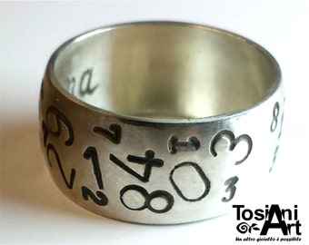 Personalized text ring, with random numbers engraved.